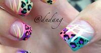 Acrylic nails. tips with colorful leopard print love >