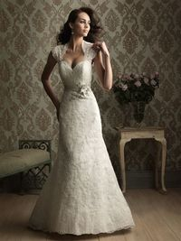 Sweetheart neckline with cap sleeves. Lace applique on net with satin band.