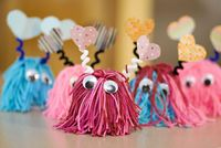 These cute pom pom valentine craft monsters are great for kids to play with at home and easy enough to make in large quantities for classroom valentines.