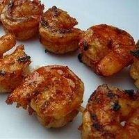 Large, plump shrimp are marinated in a savory sauce of lemon juice, garlic, italian seasoning, olive oil, dried basil, and brown sugar, then grilled to highlight the flavors.