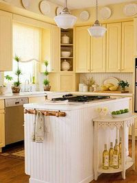 Sunny kitchen - love the buttery yellow cabinets and beadboard island!