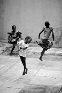 """dance"" I love this image - the movement - the composition - the children enjoying life - Would like to find photographer's name - I think I have found it. I don't know the artist's full name but I think it is GK Sholanke. S"