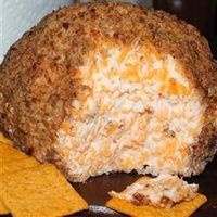 Buttermilk Ranch Cheeseball: Sour cream, ranch dressing mix, cream cheese, cheddar cheese. Rolled in pecans (or bacon bits!).