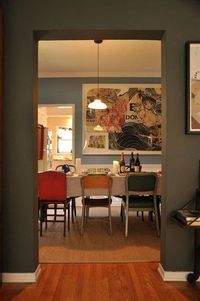 love the art, the paint, the mismatched dining table chairs...