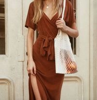 Love this brown wrap dress. It's perfect for warmer fall days. Throw on a jean or leather jacket if you need a little something extra to keep you warm.