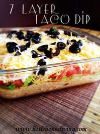 7 Layer Taco Dip. The perfect party snack or dip to feed a crowd, a favorite every time so make sure to bring extras!