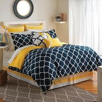 The Hampton Links Comforter Set combines modern style and easy comfort. It features a link design in yellow and navy that brings style and versatility to your bedroom.