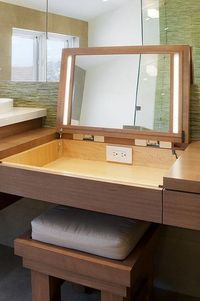 makeup table. you can hide your mess when you are done.