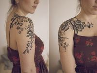 These tattoos are so beautifully rendered that you can practically hear the birds chirping and the leaves rustling.