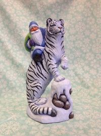 Hand-carved-Santa-on-white-tiger-by-Susan-M-Smith