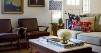 Naomi Stein of DesignManifest has no fear with it comes to blending patterns, employing ikat, pagoda print, a bright Hamadan rug, and a chevron lampshape all in one cozy space. Pair with vintage chairs and a hairpin-leg coffee table, the effect is layered...