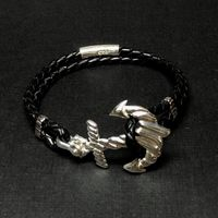 The anchor in sterling silver and natural braided leather. $195.00