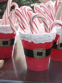 """Make these festive treat cups and fill them with candy canes, peppermint sticks, lollipops or plastic silverware for the """"child's"""" table at Christmas dinner. Make smaller versions to hold hard Christmas candy by substituting small terra cott..."""