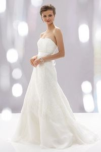 """Wtoo Rosalyn Gown. I like how there is lace on organza, so there's a mix here of stiff lace and flowy movement. The hem breaks up the """"all over lace"""" look that turns me off from other gowns."""