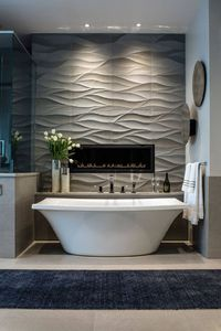 Here are 16 examples of contemporary bathrooms that have 3D bathroom tiles that add texture and a sense of luxury to the bathroom.
