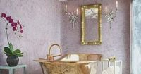 How could you not like this bathroom? An incredible tub, fanciful ceiling, lavendar color, I think I'd be in here for hours daydreaming of Roman pampering.