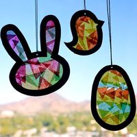 Our suncatcher template, tissue paper and transparency cutouts make a fun Easter kids craft.