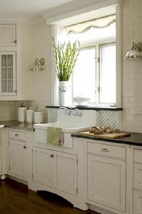 Posts Similar To Cream Cabinets Black Granite And Brick