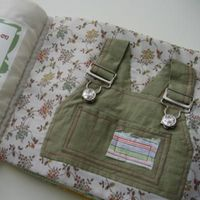 clothing book made out of your kids old clothes, teaches them how to do snaps, buttons, zippers, etc! awesome!