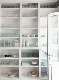 Floor-to-ceiling shelving in the impeccably stocked kitchen.