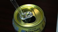 If you've ever tried using a straw with a can of soda, you now what happens: the straw comes flying out and falls onto your desk. Reddit user triggerhoppe solve