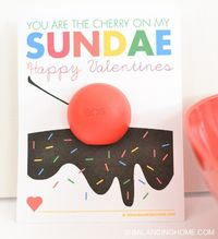 Spread the love with this EOS Valentine printable. This adorable sundae is topped with and EOS lip balm as a cherry! Part of an EOS lip balm printable Valentine