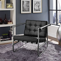 SERENE STAINLESS STEEL LOUNGE CHAIR w/Black Padded Vinyl Cushions With Buttons