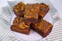 the chew | Recipe | Carla Hall's Pumpkin Cream Cheese Brownies