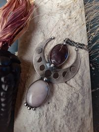 Silver Plated Crescent Moon, Moon Phase Pendant with rose quartz and amethyst stone. $67.00