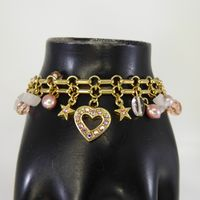 Kirks Folly Heart & Stars Charm Bracelet in Gold Tone Double Wide Chain with Bezel Set with Dangling Pink and White Quarts and Faux Pearls $75.00