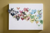 Hearts on canvas. I used this as an inspiration for a project with my toddler son. I cut out hearts in different sizes from several coordinating scrapbooking paper. My son then glued them (with my help) onto canvas. I didn't help with placemen...