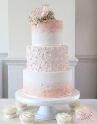 We don't know what we love most about this cake, the blush pink color or the watercolor effect? It's hard to ignore that gorgeous gold leaf too...