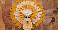 Umm�€� a cheese tukey shaped cheese tray?!!! Can also use salami and pepperoni and use crackers all around the outside.