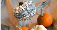 Use Mod Podge and strips of scrapbook paper to make an easy Damask Pumpkin.