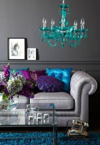I love the shades of blue and purple and the chandelier. Really plays off the gray.
