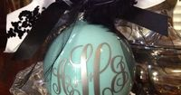 Monogram Ornament. I put Martha Stewart SURF paint inside the bulb, making sure to evenly coat the entire inside of the bulb. Once coated, I left upside down overnight to dry, sitting on a cup. Added my monogram (with silver vinyl), added the ribb...