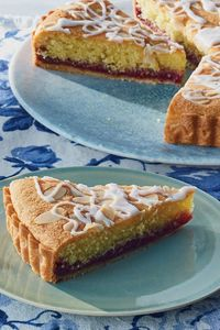 """A classic British bakewell tart is a threesome: a crust; a layer of raspberry jam �€"""" one chockfull of seeds; and a sponge cake redolent of almonds. Sliced almond"""