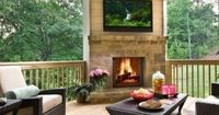 Outdoor living space. Love this deck with a fireplace & television & the view!