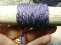Identify the weight of yarn with a dowel. Wrap the yarn around counting the times it goes around in one inch. Worsted? Sport? Bulky? Awesome!
