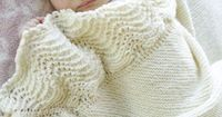 New Drops patterns for baby No. 25 - Knitted DROPS blanket in garter st with edge Wave pattern in �€Baby Merino�€. ~ DROPS Design