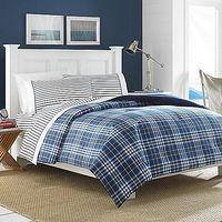 Give your bedroom a fashionable coastal appeal with the Millbrook comforter set. This set features classic Nautica styling with a soft plaid pattern in an array of blues and white, while the included sheet set has a coordinating stripe design.