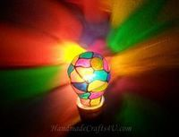 DIY Stained glass light bulb ...could probably done with sharpie [: