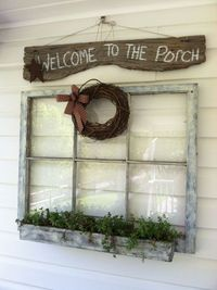 Love the wreath and sign on and above the window. by liza