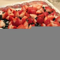 Graham cracker crust, whipped cream, cream cheese, vanilla pudding, and sweet berries all in this dessert. A perfect treat for the hot summer months! - ruggedthug