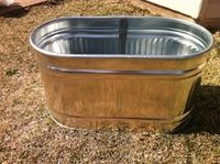 Whether you call it a stock tank, a galvanized metal container, or a cattle trough (being from Texas, I prefer the latter), one thing's for sure: these metal bi