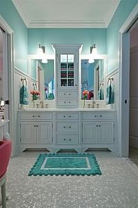 Love the floor tiles. And the wall color with the white cabinetry