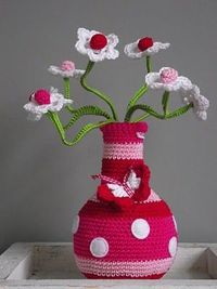 Crochet covered vase with crochet flowers. Cute!