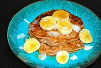 Coconut Banana Pancakes: Mashed banana and coconut milk make these pancakes super moist and delicious!