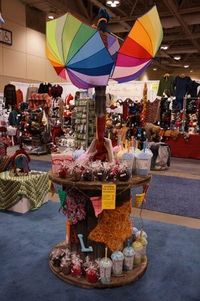 Crochet Display, Old Wire Spool, Cardboard, and Umbrella's from Walmart. Voila, instant creative display.