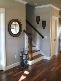 """LOVE this paint color! Sherwin Williams """"Pavillion Beige"""" those floors and stairs are beautiful."""